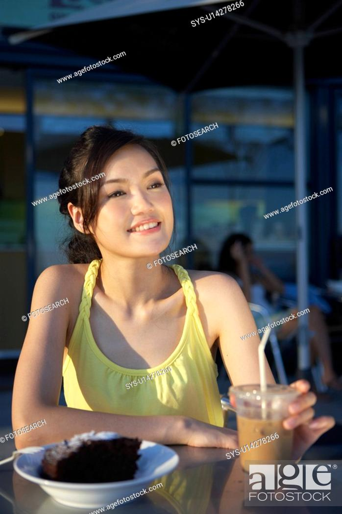 Stock Photo: Young Lady Sitting at Outdoor Cafe, Looking Away.