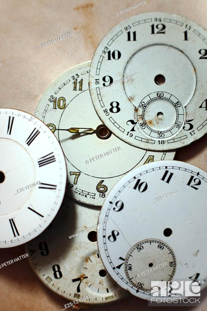 Stock Photo: Five old watch faces mostly without hands.