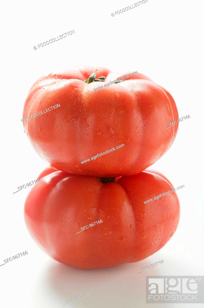 Stock Photo: Two beefsteak tomatoes, one on top of the other.