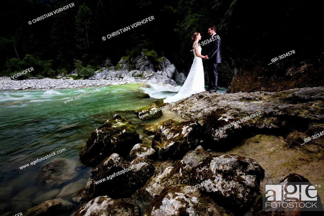 Bridal Couple Standing Beside A Torrent And Looking Lovingly At One