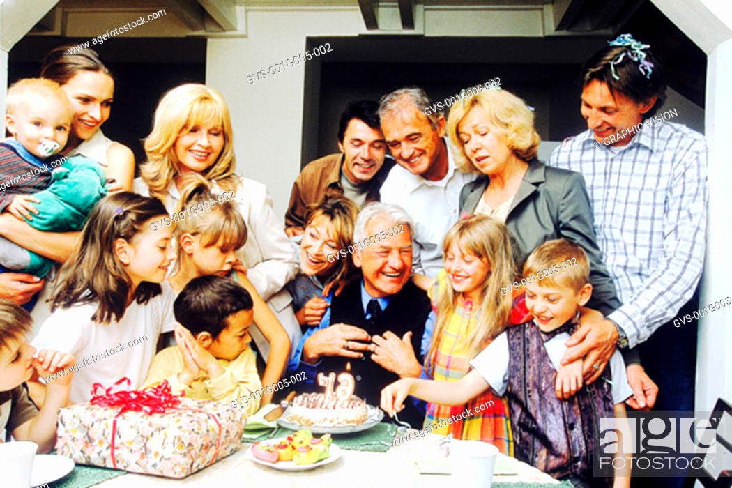 Stock Photo: Portrait of a family celebrating grandfather's birthday.