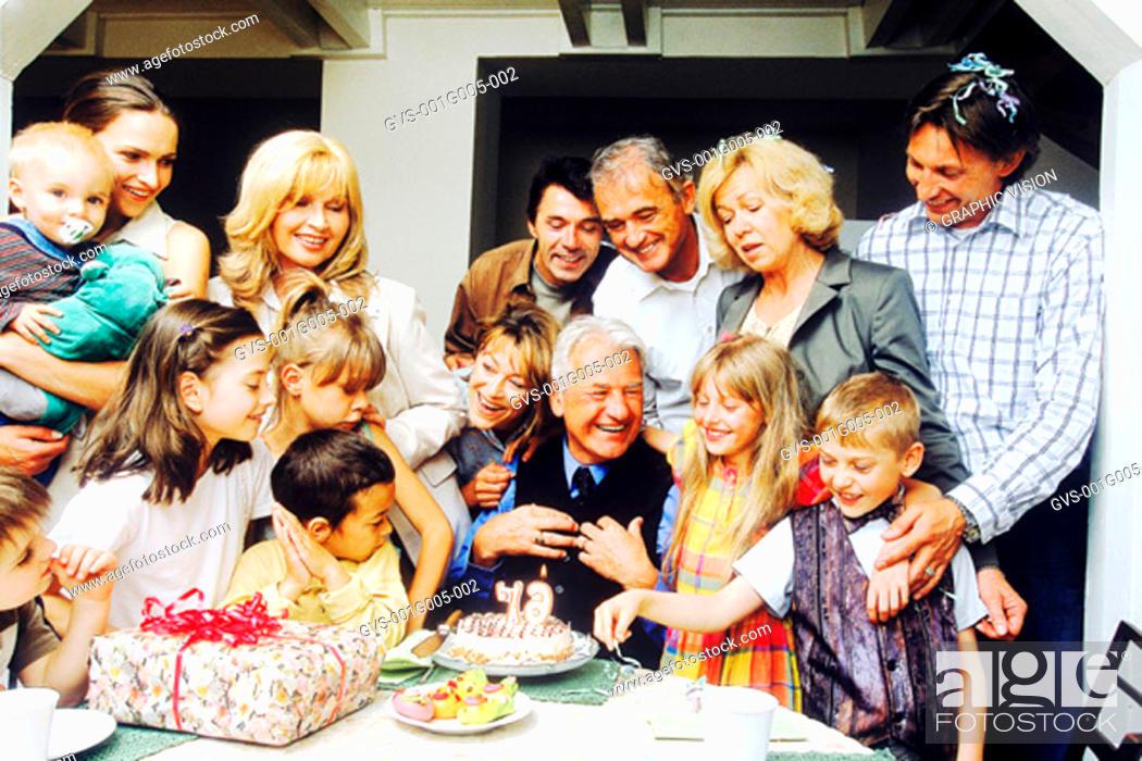 Stock Photo: Portrait of a family celebrating grandfather's birthday.