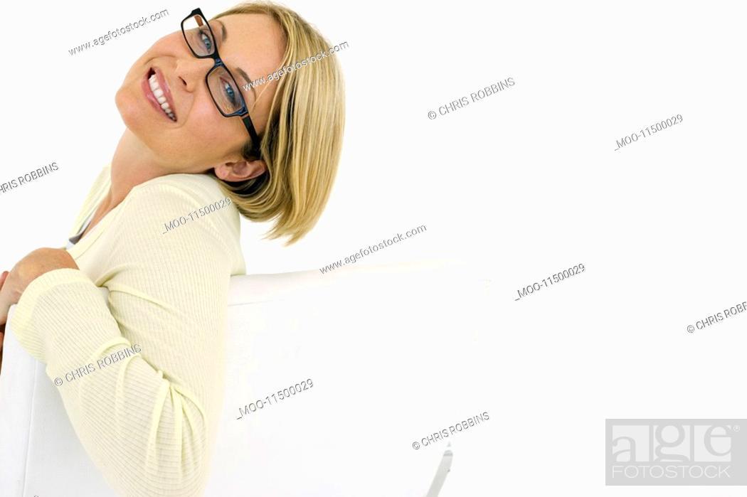 Stock Photo: Businesswoman smiling on white background portrait.