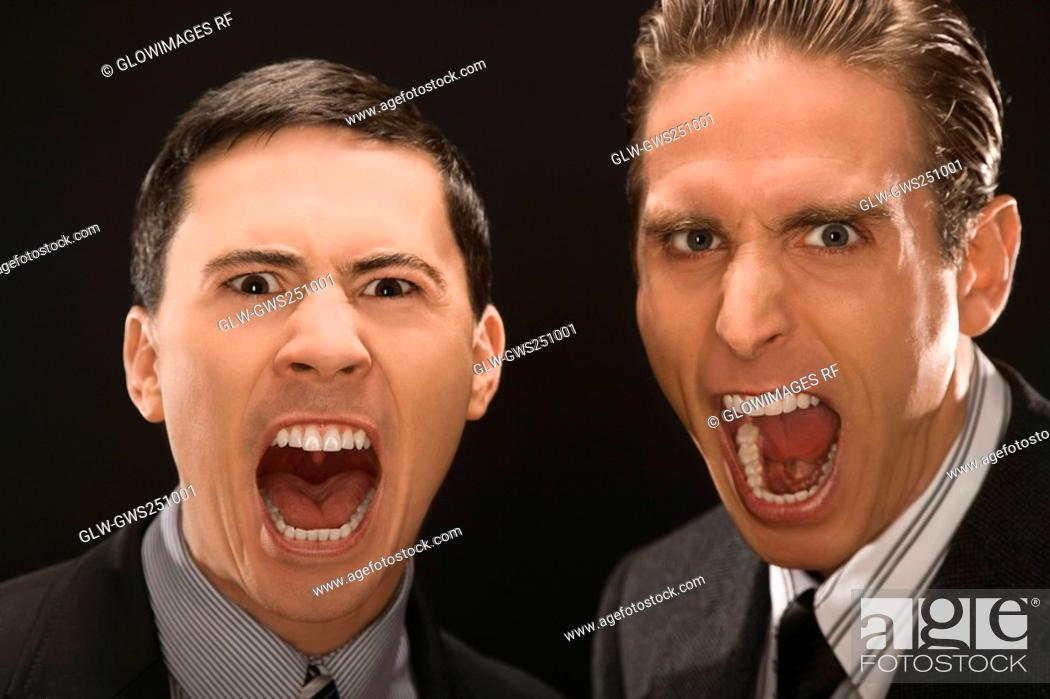 Stock Photo: Portrait of two businessmen shouting.