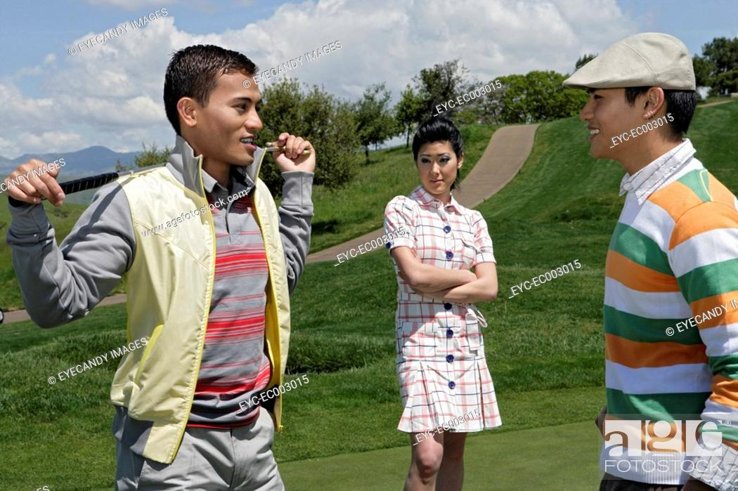 Stock Photo: View of two men having discussion during a golf game.