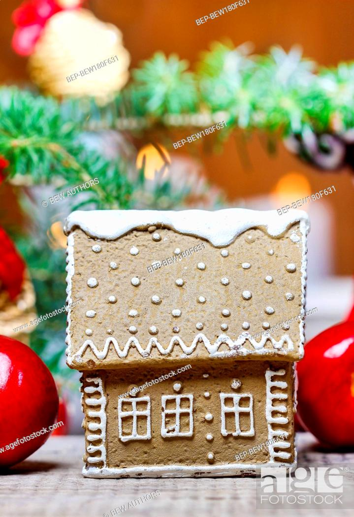 Stock Photo: Gingerbread house by the fir branch on christmas eve table.