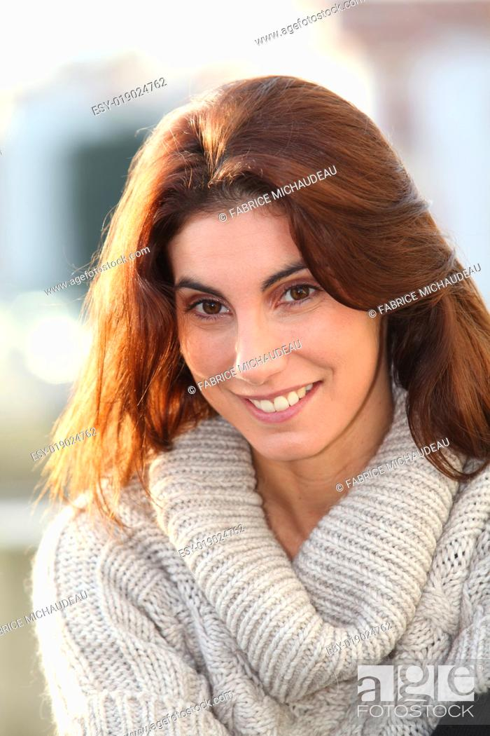 Stock Photo: Portrait of beautiful young woman in town.