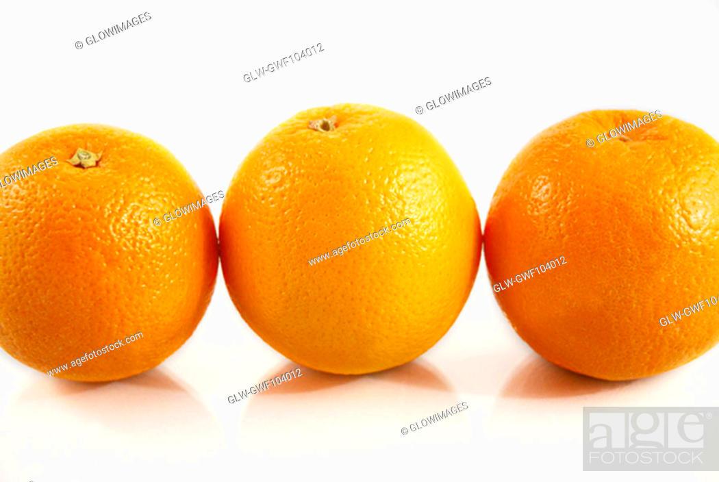 Stock Photo: Close-up of three oranges.