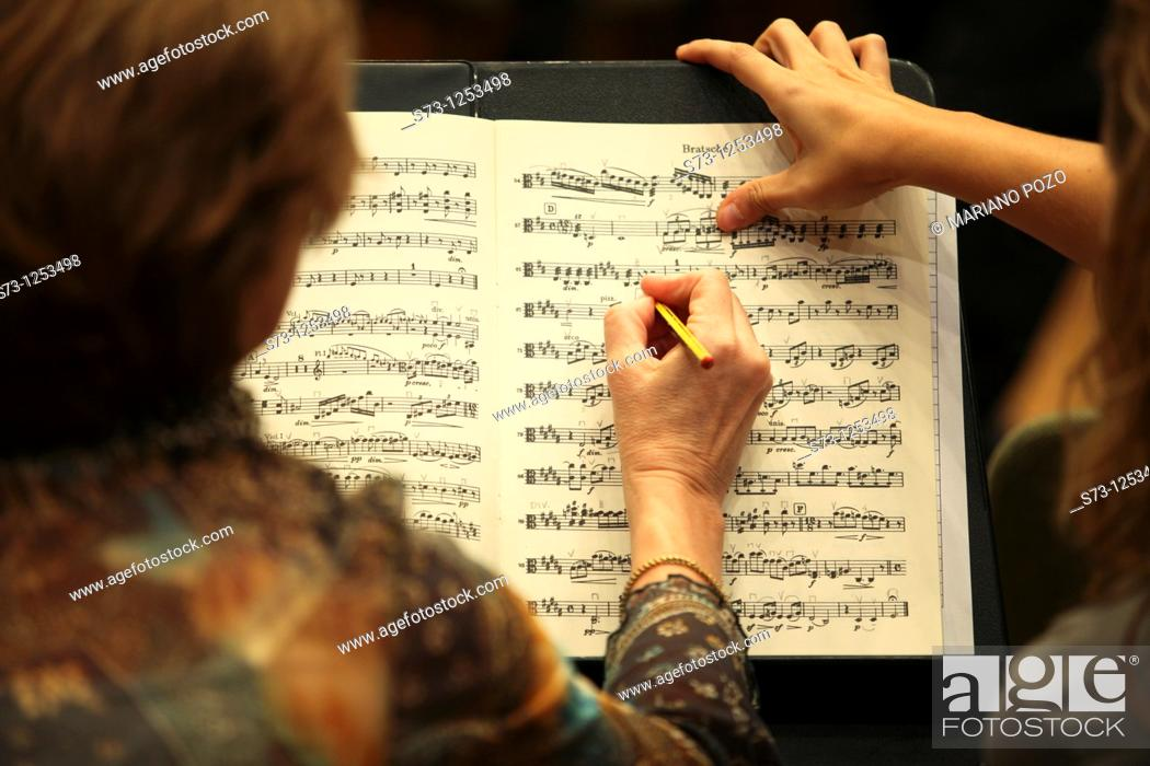 Stock Photo: Musicians with a score.