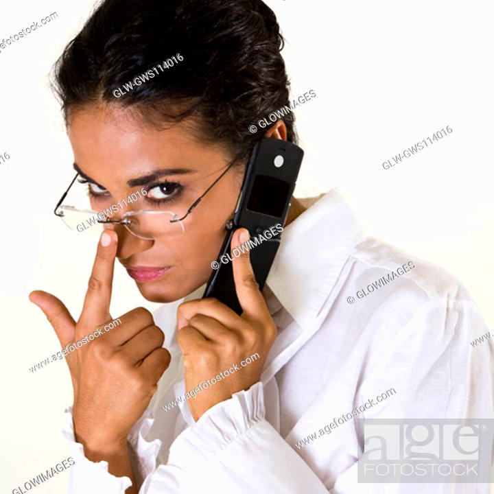 Stock Photo: Portrait of a young woman talking on a mobile phone.
