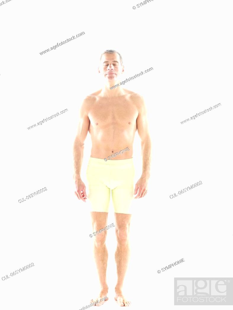 Stock Photo: Mature man in fitness shorts.