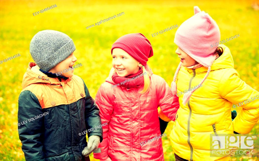 Stock Photo: childhood, leisure, friendship and people concept - group of happy children in autumn park.