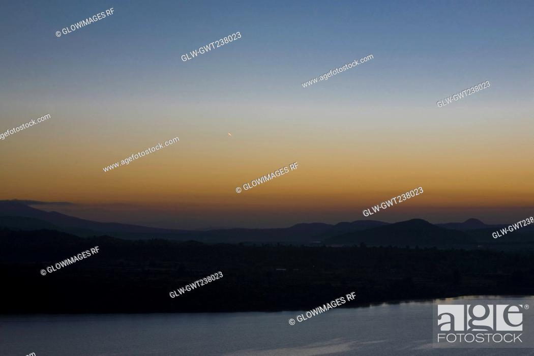Stock Photo: Silhouette of an island at dusk, Janitzio Island, Lake Patzcuaro, Morelia, Michoacan State, Mexico.