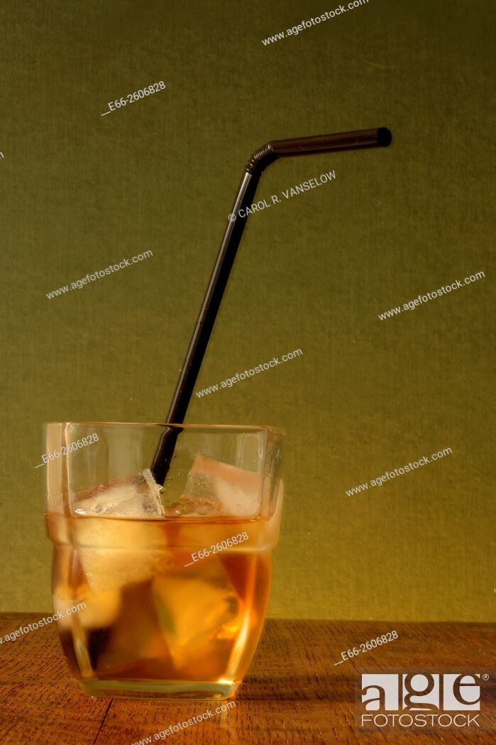 Stock Photo: Shot of whiskey on the rocks with black bending straw. Concept: under age drinking.