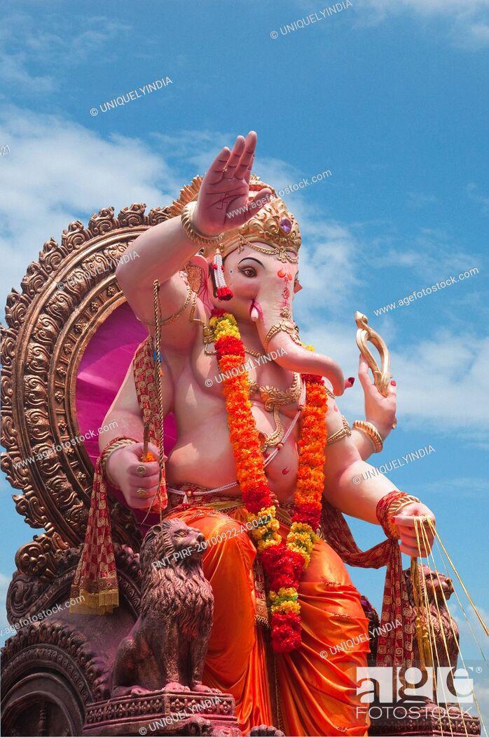 Stock Photo: Low angle view of idol of Lord Ganesha, Mumbai, Maharashtra, India.