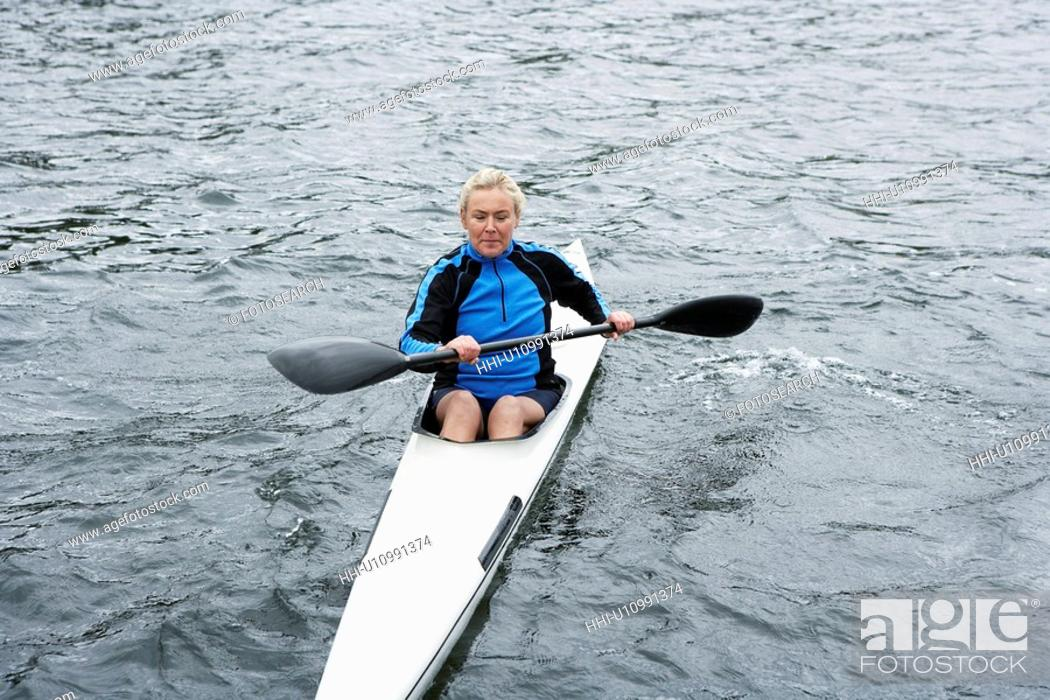 Stock Photo: Mature woman kayaking.