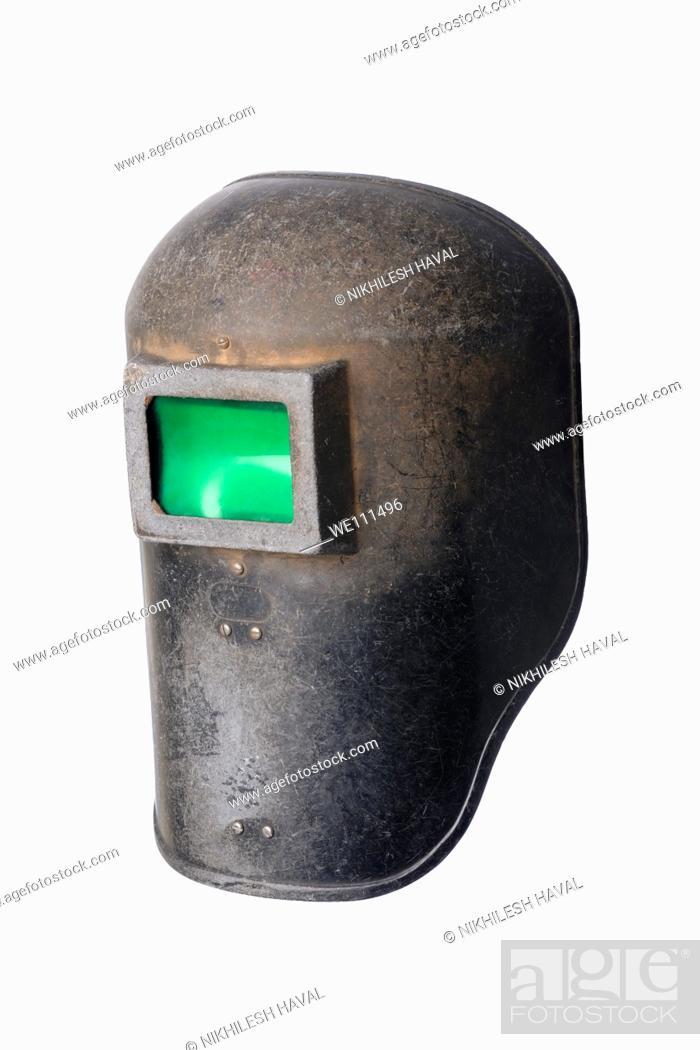 Stock Photo: Used old welding helmet mask.