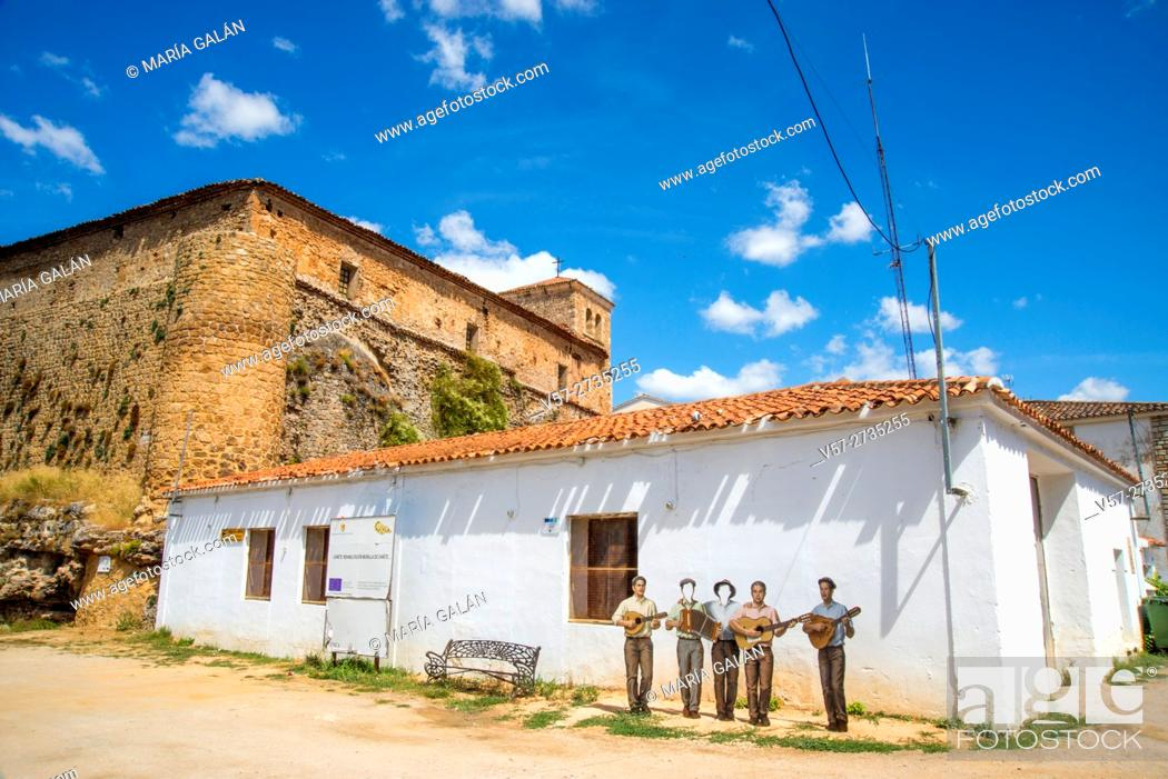Stock Photo: Modern sculpture and church. Cañete, Cuenca province, Castilla La Mancha, Spain.