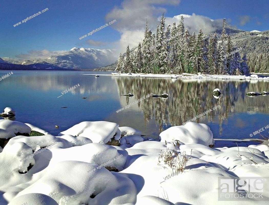 Stock Photo: Snow on rocks on the shore of Lake Wenatchee, Lake Wenatchee State Park, Washington State, USA.