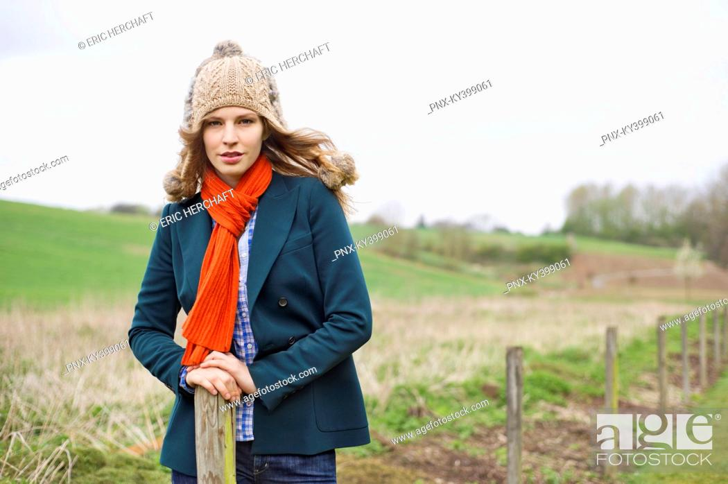 Stock Photo: Portrait of a woman standing in a field.