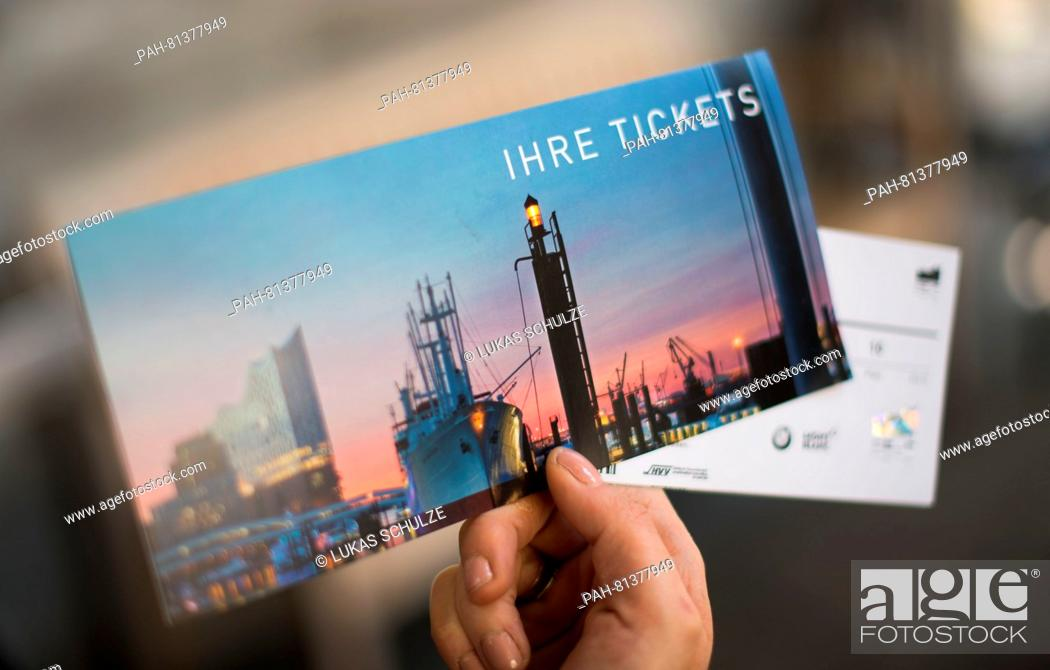 Stock Photo: A woman holds up a ticket for the Elbe Philharmonic Hall at Kulturcafé in Hamburg, Germany, 20 June 2016. The ticket sales started half a year prior to the.