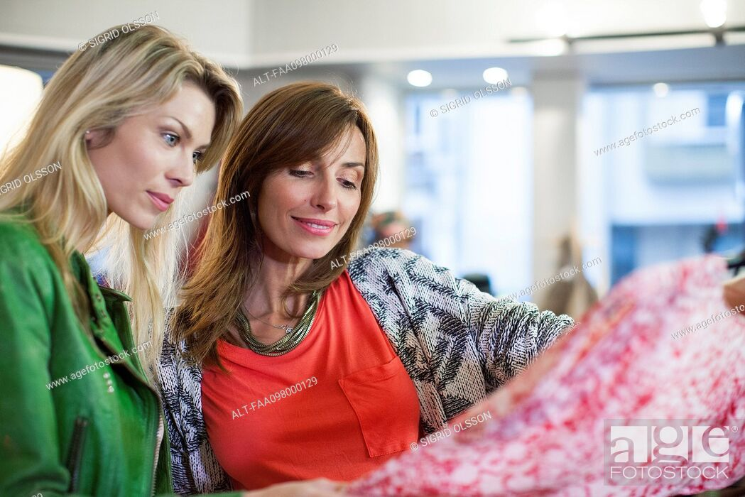 Stock Photo: Women dress shopping together.