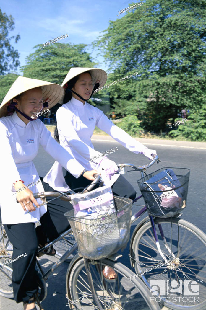 Stock Photo: Vietnam, Mekong delta, Can Tho, Schoolgirls, straw hats, driving wheels Southeast Asia, natives, girls, students, Women, young, Vietnamese, two, cyclists.