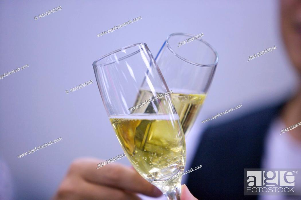 Stock Photo: People toasting with glass of champagne.