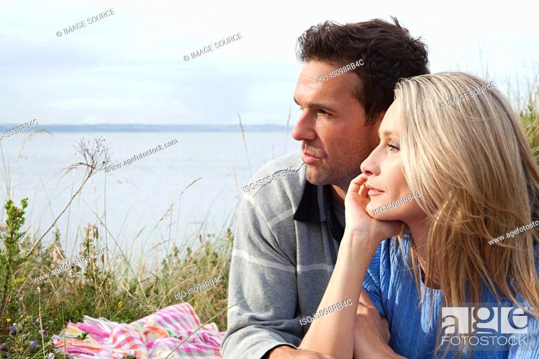 Stock Photo: Couple outdoors looking towards sea.