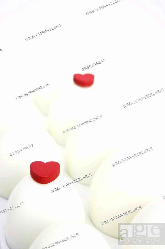 Stock Photo: heart shapes on the eggs.
