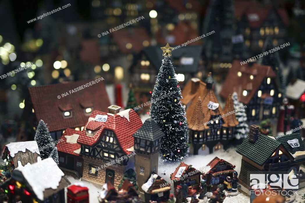 Stock Photo: Porcelain houses with a Christmas tree can be seen at the Christmas market in Dortmund, Germany, 30 November 2017. Photo: Ina Fassbender/dpa.