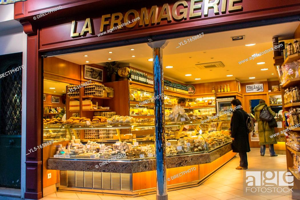 Stock Photo: Paris, France, People Shopping in French Cheese Store, 'La Fromagerie' on Montorgeuil Street, at Night.