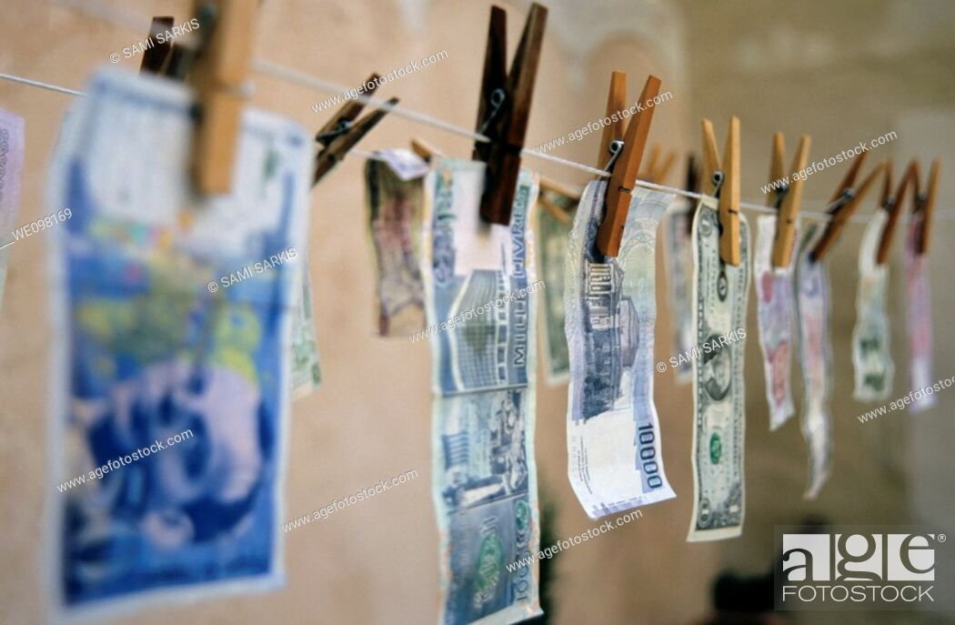 Stock Photo: International banknotes drying on a washing line.