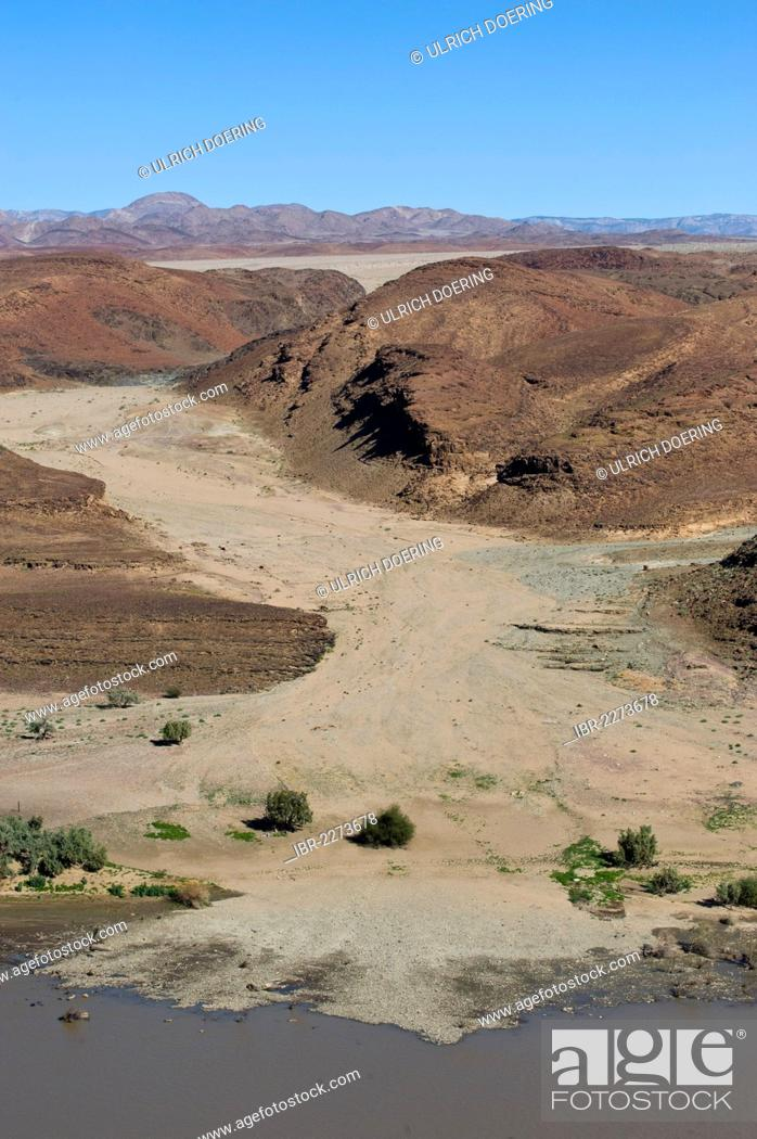 Stock Photo: Dry river bed in Richtersveld National Park South Africa, view across the Oranje River from a view point west of Aussenkehr, Namibia, Africa.