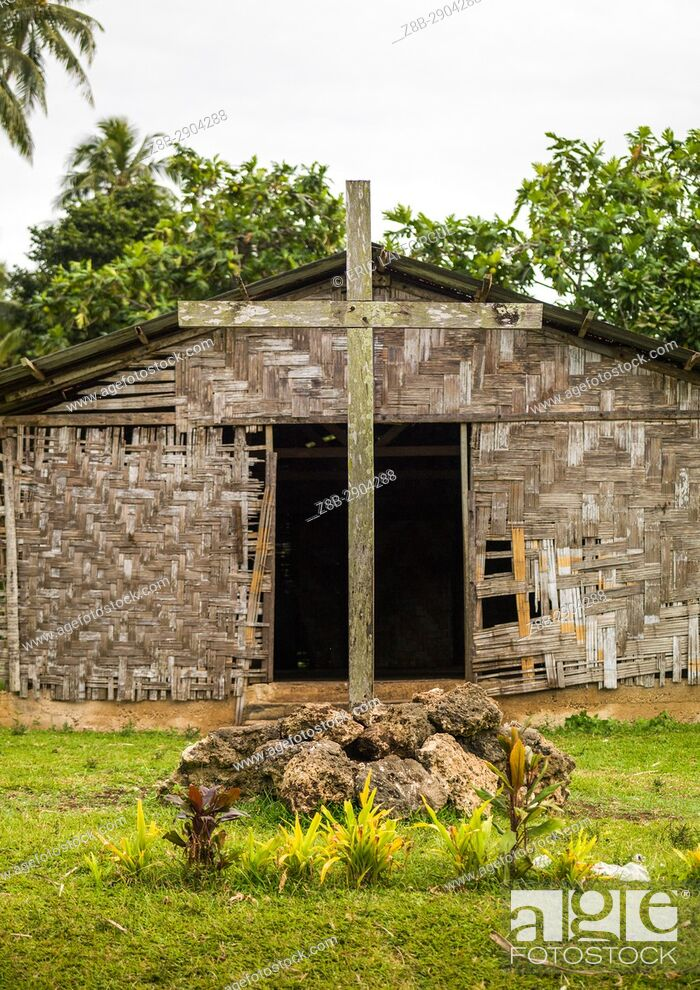 Stock Photo: Tomb with a cross in front of a traditional house made with palm leaves, Malampa Province, Malekula Island, Vanuatu.