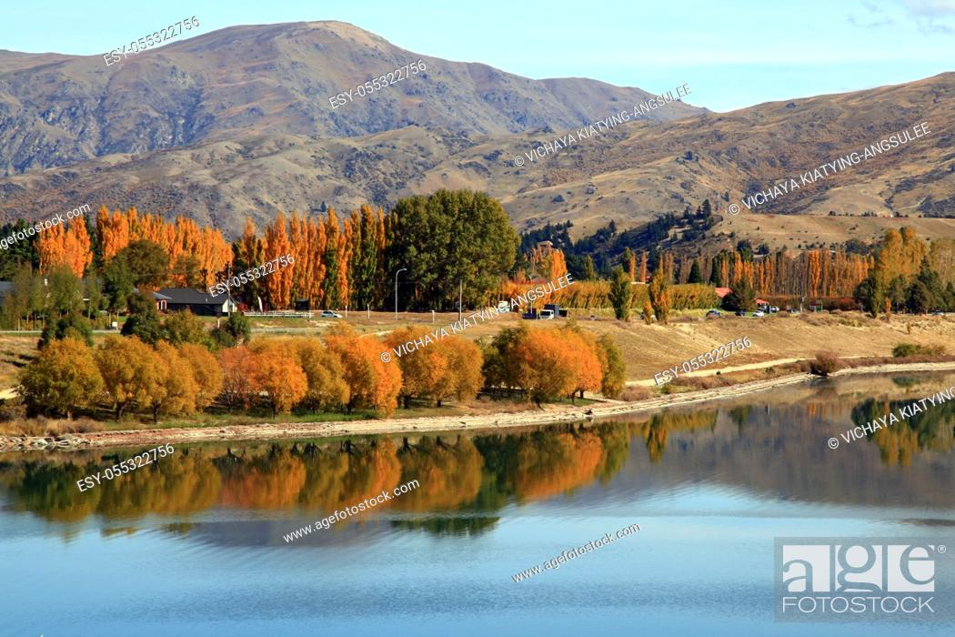 Stock Photo: panorama of lake dunstan reflection in New Zealand near Queenstown.