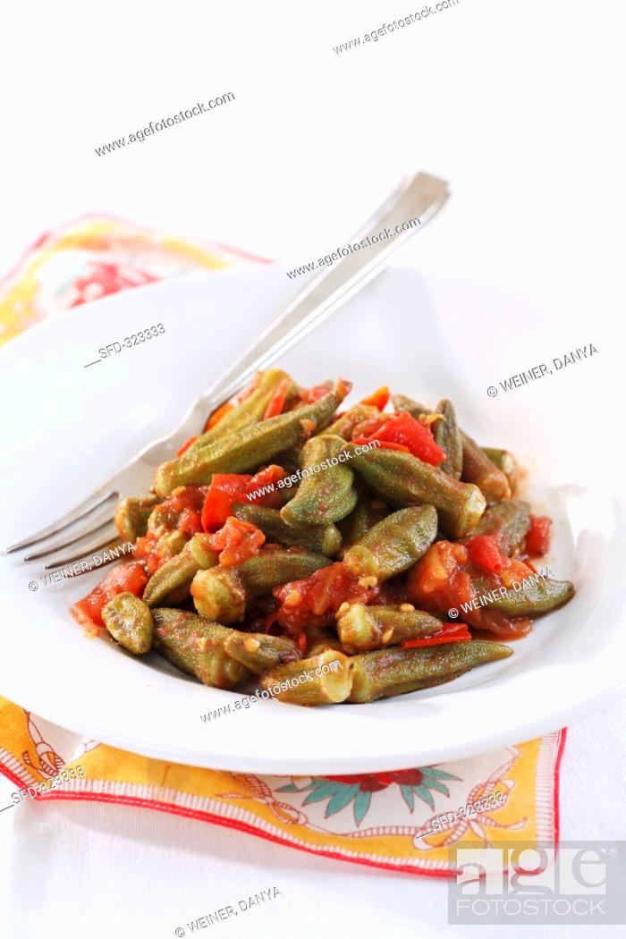 Stock Photo: Okra pods with tomatoes.