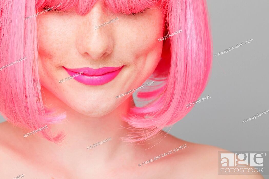 Stock Photo: Close up of teenage girl with pink hair.