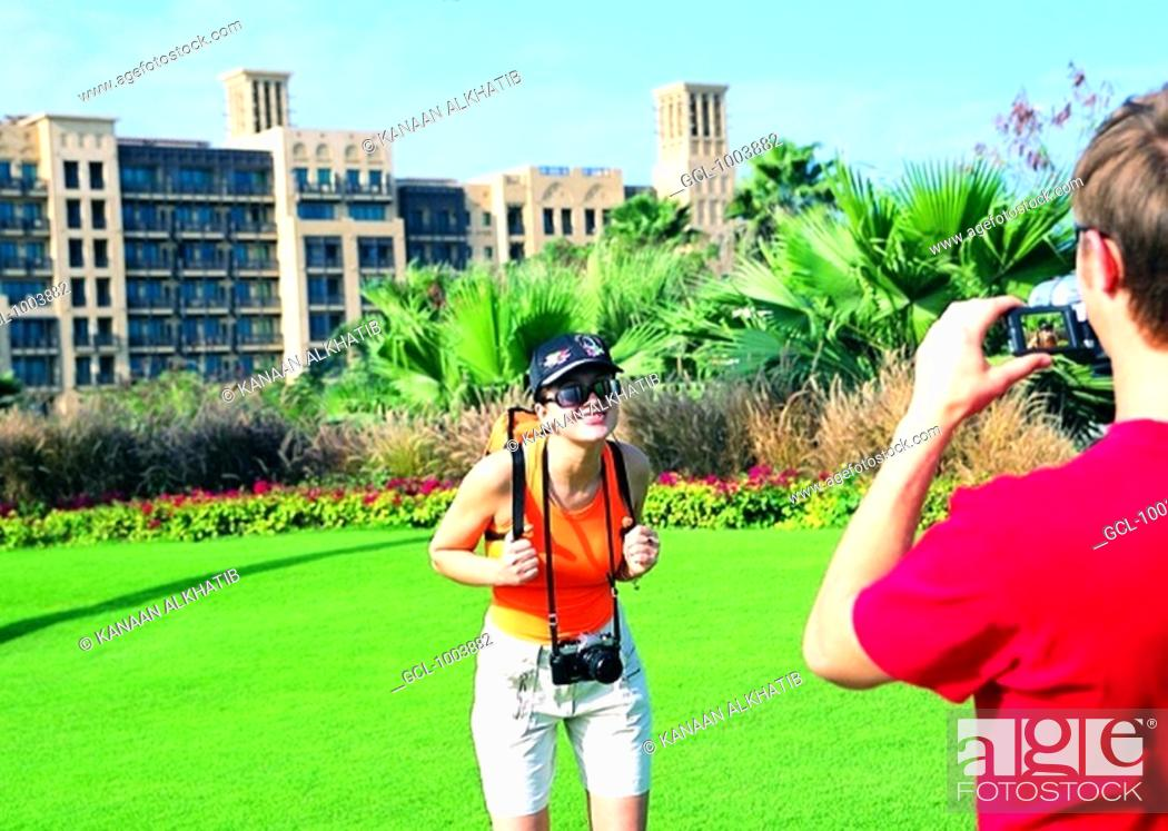 Stock Photo: Western tourists photographing in front of Mina Al Salam hotel in dubai, UAE.