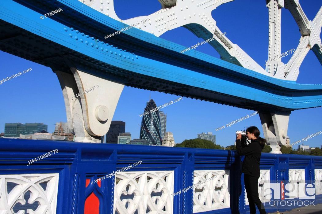 Stock Photo: Great Britain, England, UK, United Kingdom, London, travel, tourism, bridge, trees, Tower, Swiss Re, gherkin, girl, take photos,.