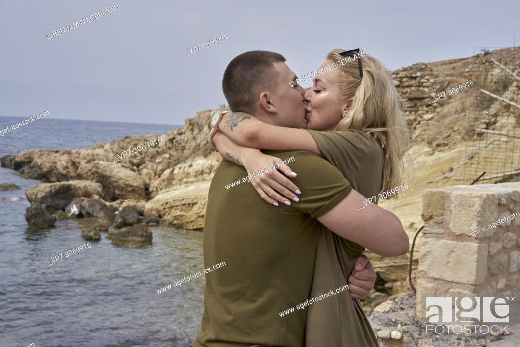 Photo de stock: Young couple kissing, Russian ethnicity, Hersonissos, Crete, Greece.