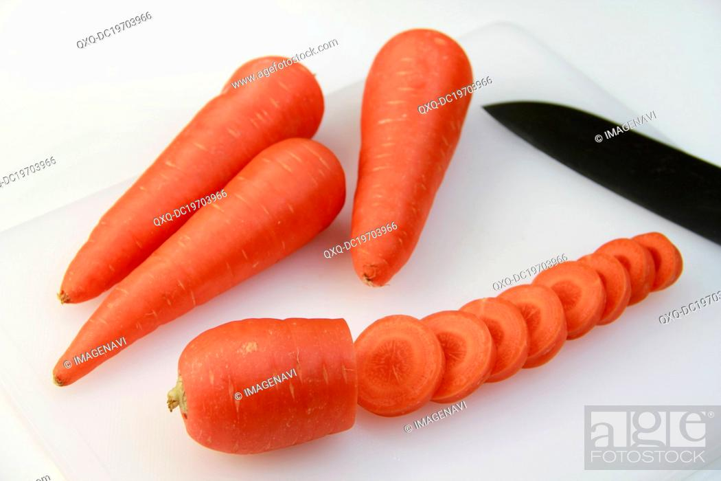 Stock Photo: Carrots on chopping board.