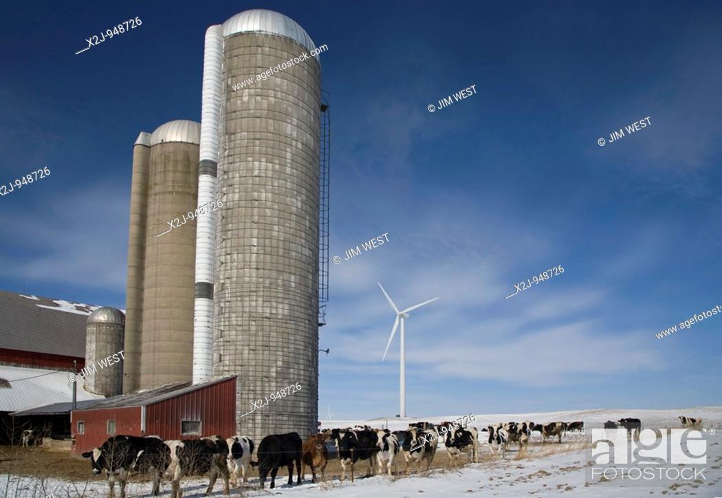 Stock Photo: Ubly, Michigan - A wind turbine on a farm in the Noble Thumb Windpark, owned by John Deere Wind Energy  The wind farm uses 46 wind turbines to generate 69.