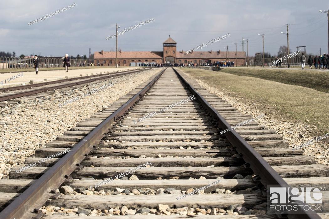 Stock Photo: Rail entrance to concentration camp at Auschwitz Birkenau KZ Poland March 12, 2019 war.