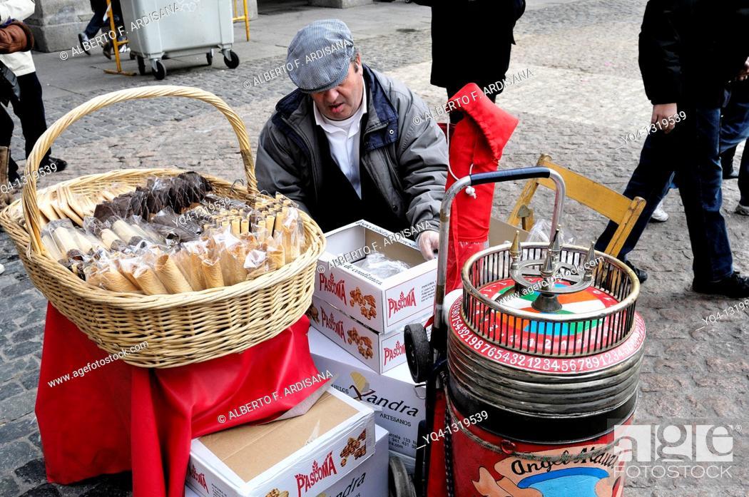 Stock Photo: Seller waffles, on the Plaza Mayor of Madrid.