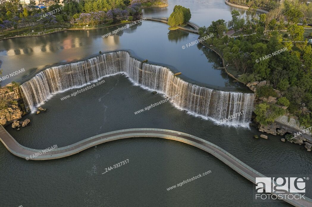 Stock Photo: Aerial view of the Kunming Waterfall Park at sunset, one of the largest manamde waterfalls in the world.
