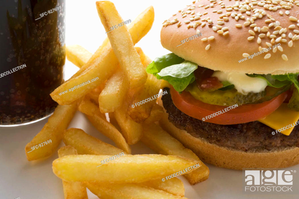 Stock Photo: Cheeseburger with chips and Cola.
