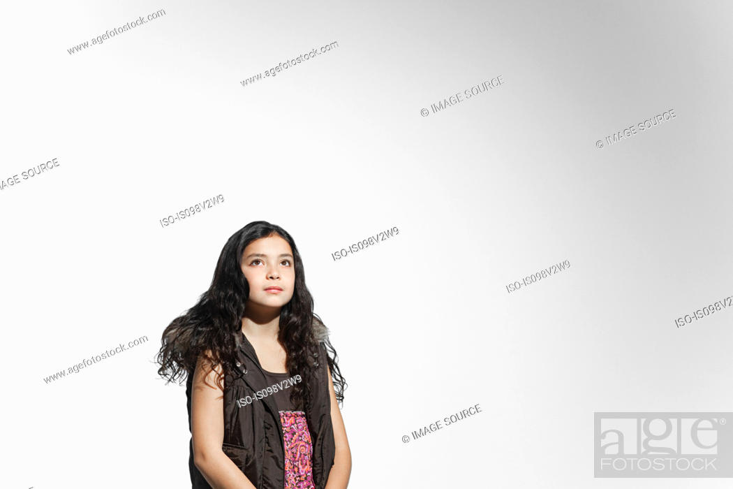 Stock Photo: Girl looking up.