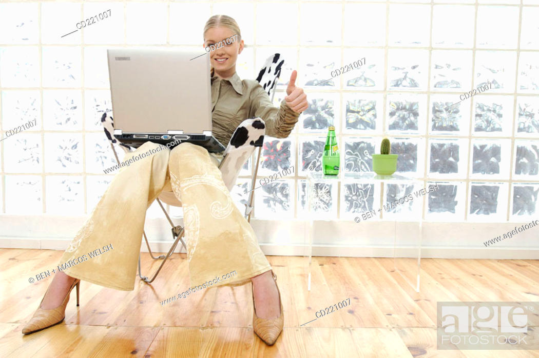 Stock Photo: Business woman working with portable computer.