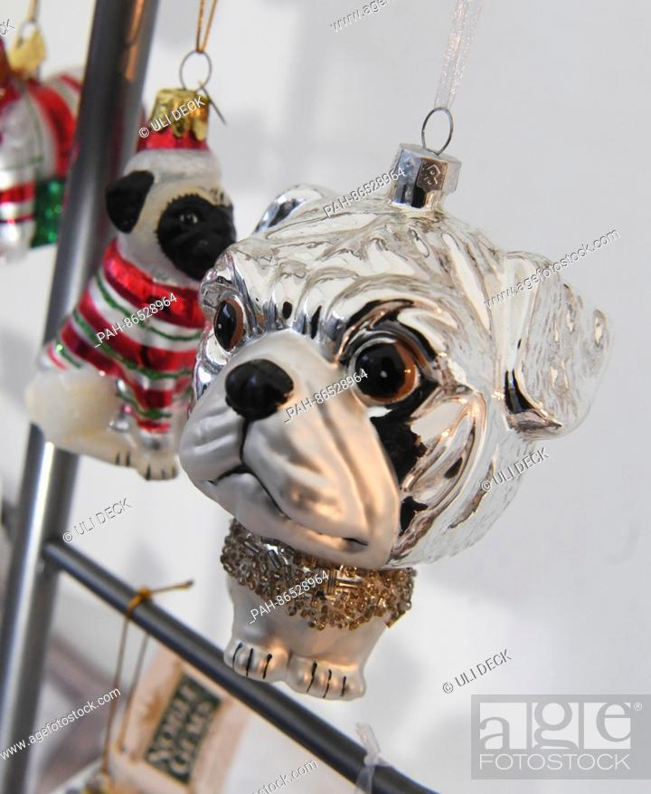 Dogs First Christmas Ornament.Christmas Ornaments In The Shape Of Dogs Can Be Bought At